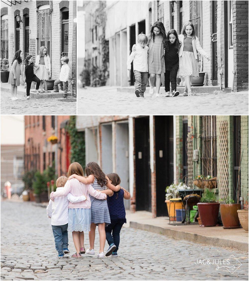 Kids walking on cobblestone street in Hoboken, NJ.