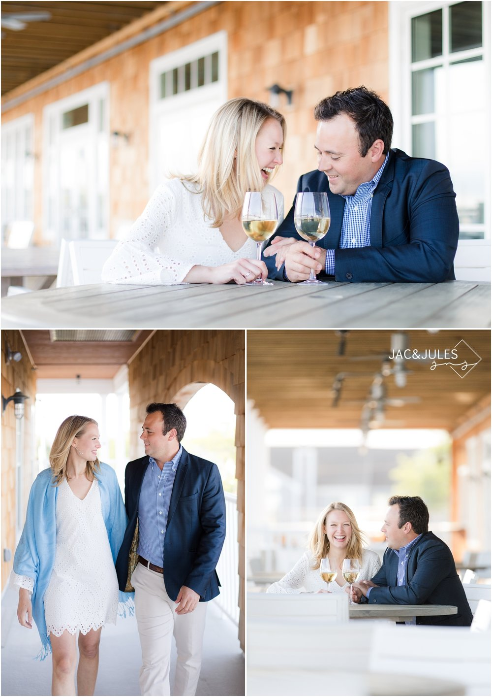 Engagement photo of couple sharing a glass of wine at Bay Head Yacht Club in New Jersey