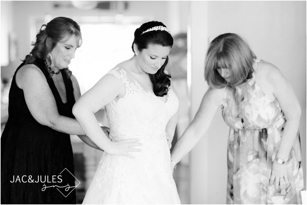 bride gets dressed for her wedding in seaside nj