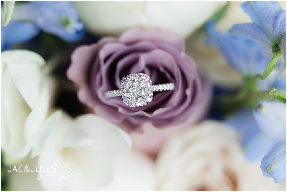 jacnjules photograph engagement ring in the bride's soft colored bouquet