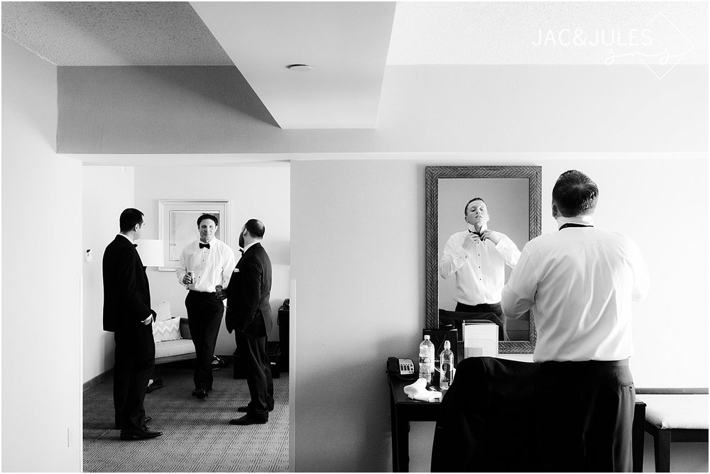 groom gets ready at double tree in Tinton Falls NJ