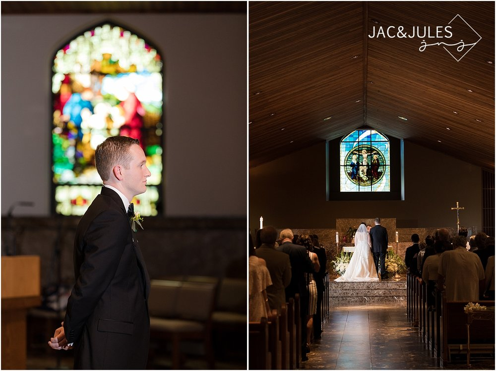 groom sees his bride for the first time on their wedding day at st dennis church in manasquan