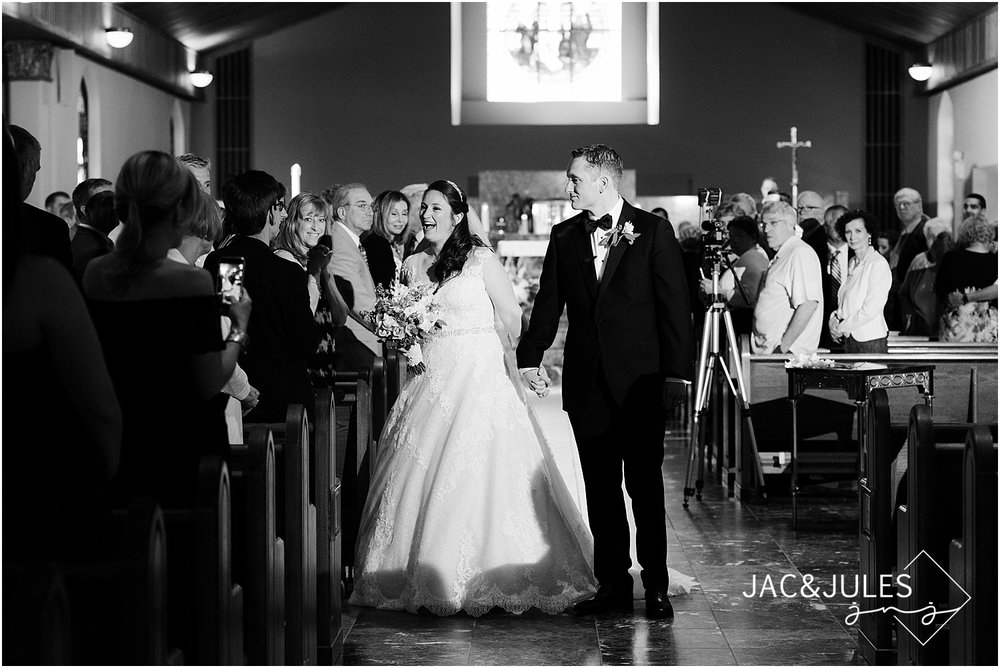 bride and groom exit their wedding ceremony in manasquan nj