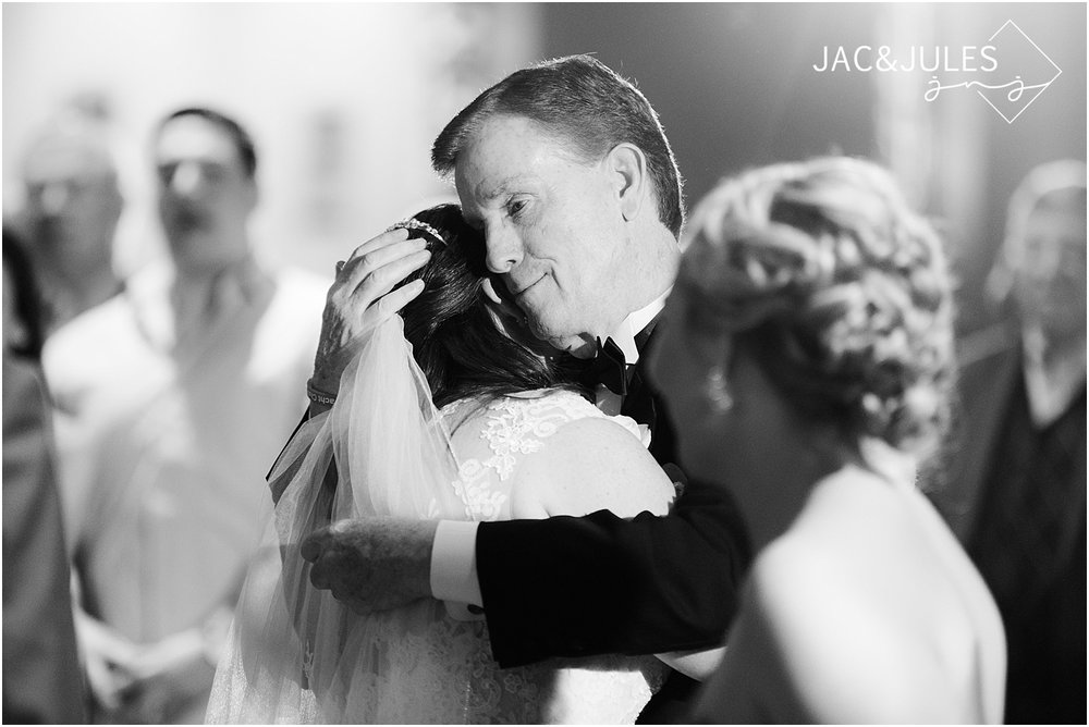 father hugs his daughter at her wedding in manasquan nj