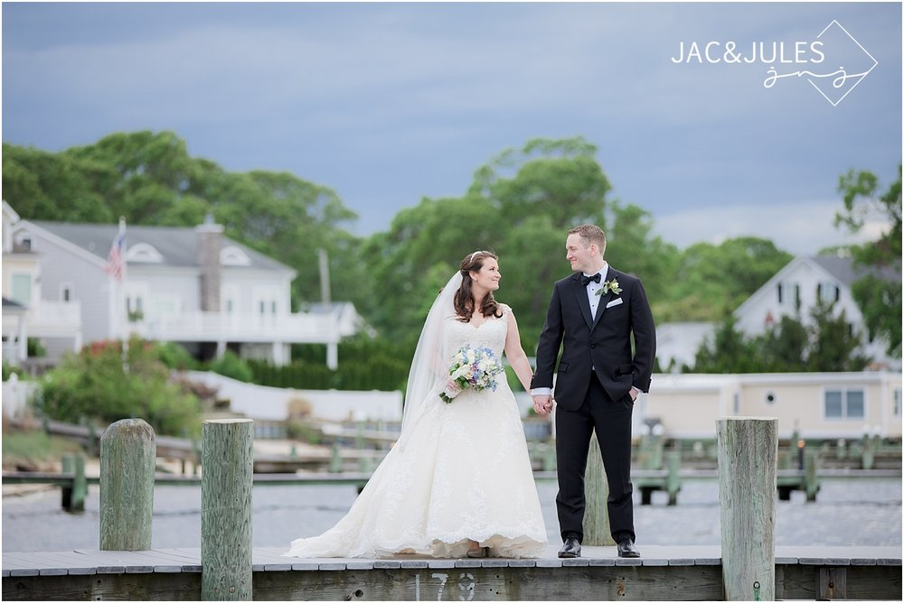 bride and groom photo on the dock at clarks landing wedding