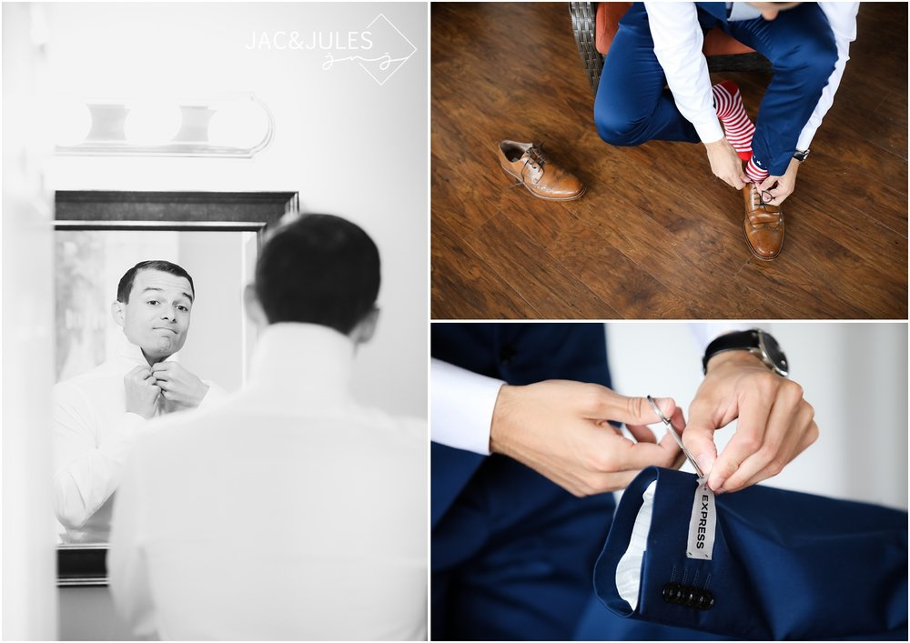 Groom getting ready wearing Navy suit from Express.