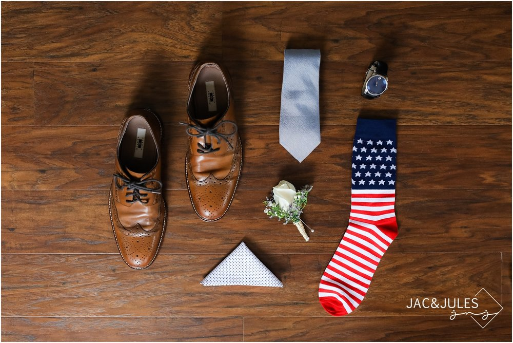 Groom accessories, patriotic american flag socks, boutineer, and Movado watch