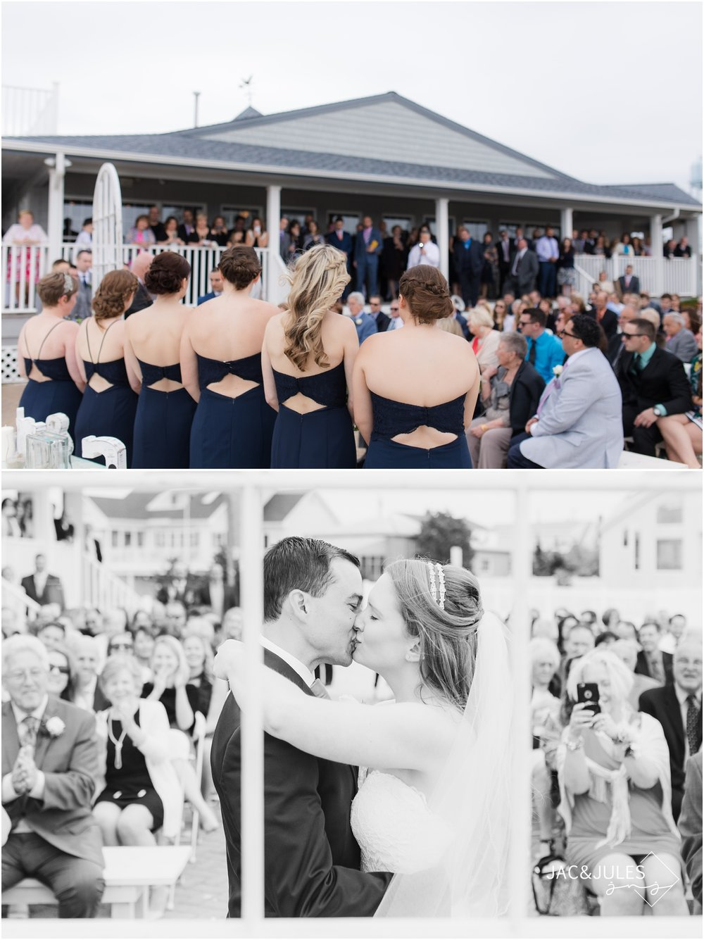 First kiss at wedding ceremony at Brant Beach Yacht Club in Beach Haven, NJ.