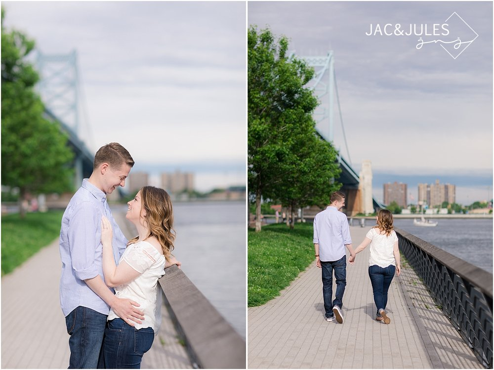 engagement photos under ben franklin bridge in philadelphia
