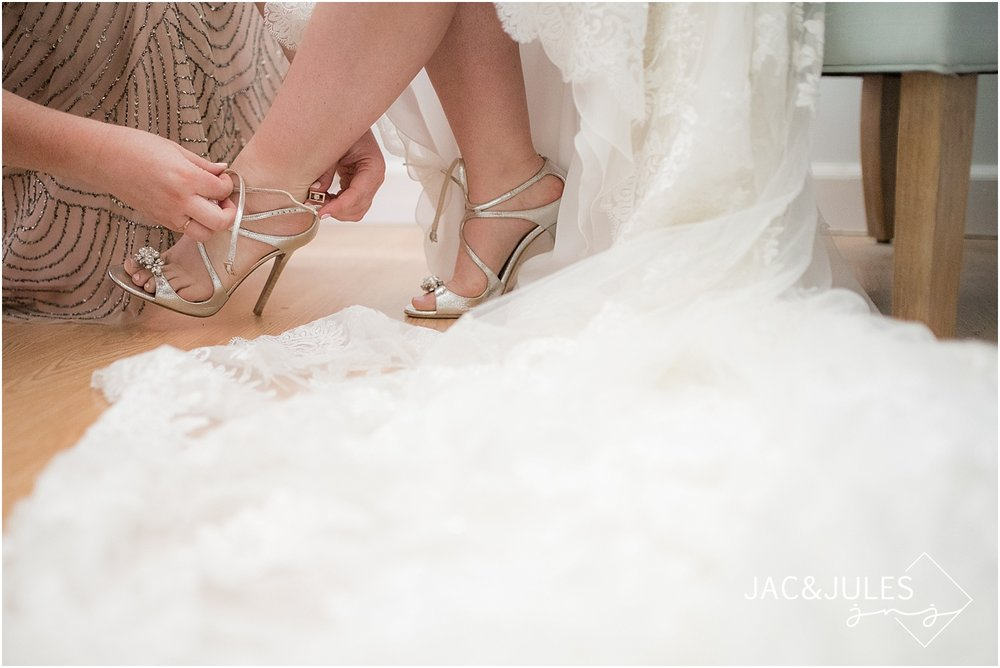 bride puts on jimmy choo shoes for her wedding