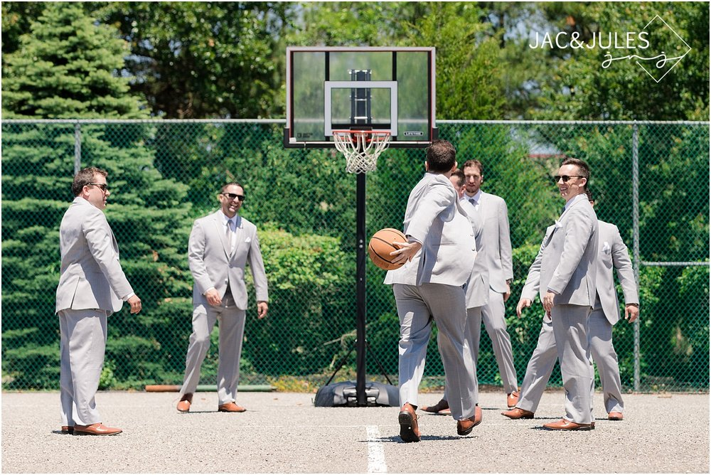 groomsmen have fun playing basketball at ramada inn in toms river nj