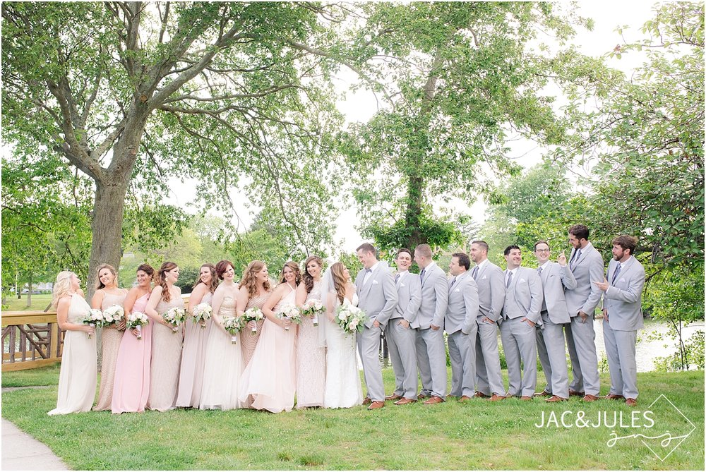 fun bridal party photo at divine park in spring lake nj using natural light