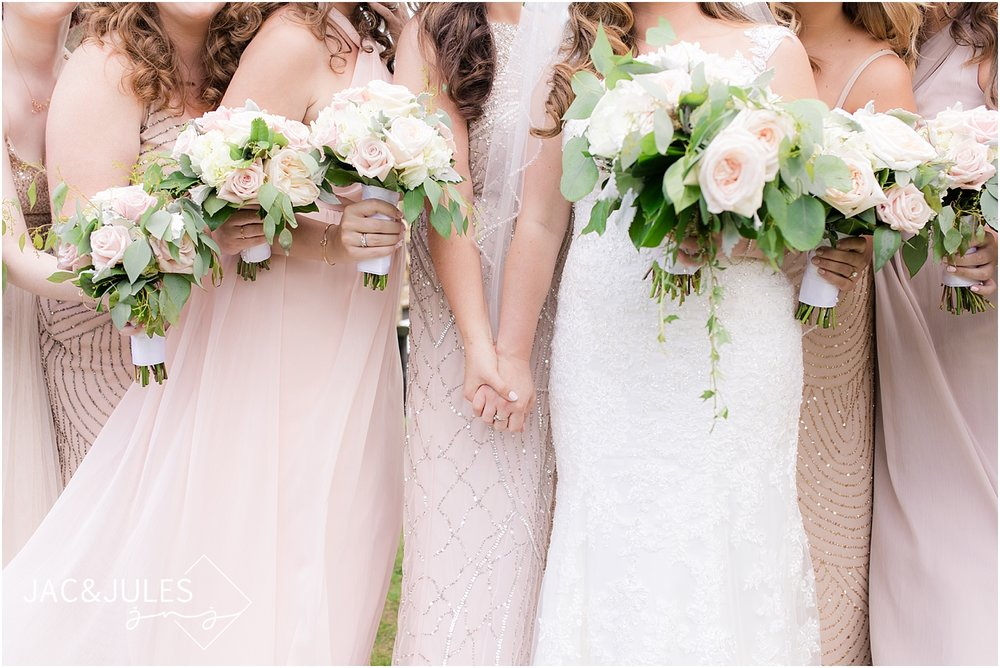 blush bridesmaid dresses and wedding flowers by narcissus florals in spring lake nj