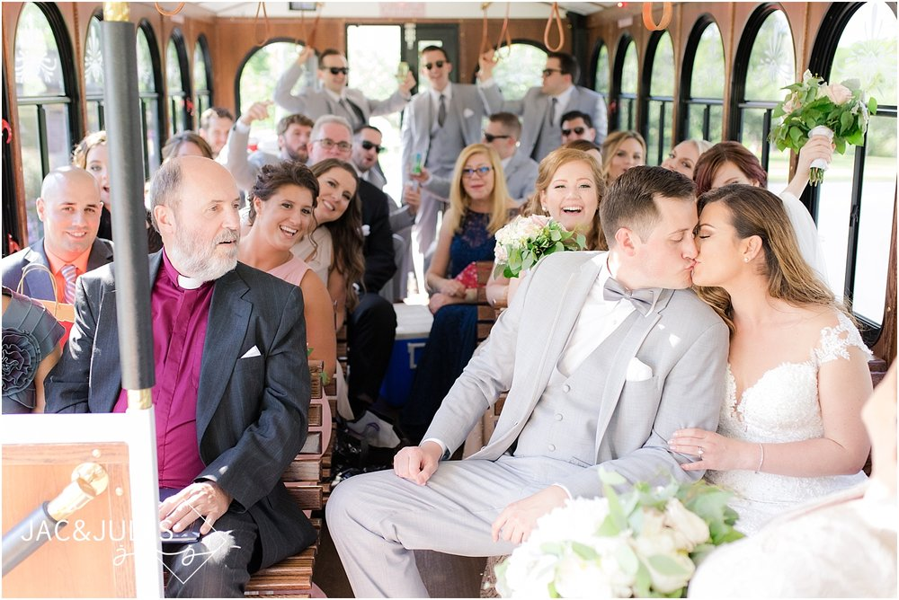 bride groom and bridal party on the trolley for their wedding in spring lake nj