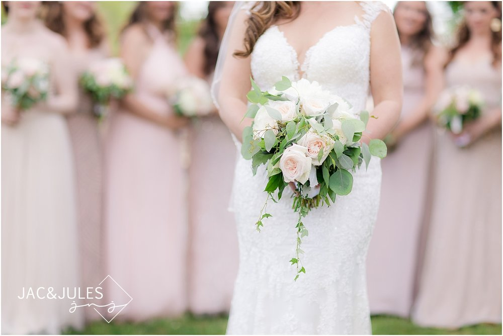 blush bridesmaids dresses at a spring lake wedding
