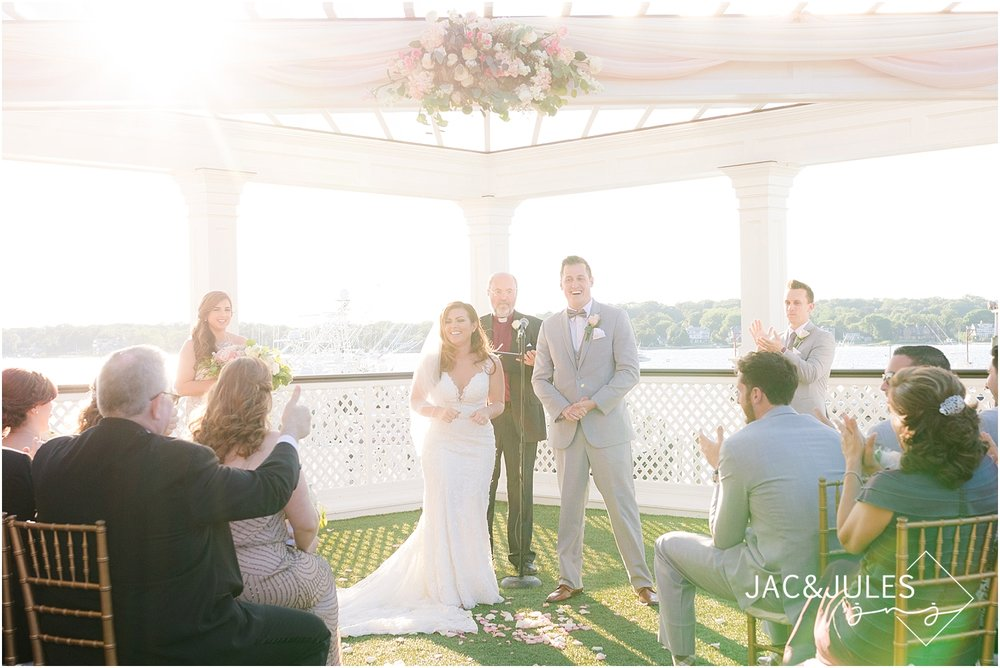 outdoor wedding ceremony at sunset at clarks landing in point pleasant nj