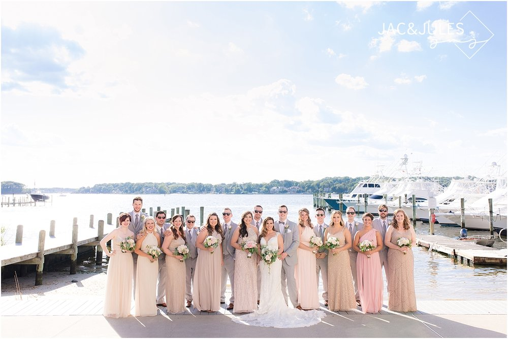 bridal party photo on the dock at clarks landing yacht club in point pleasant nj