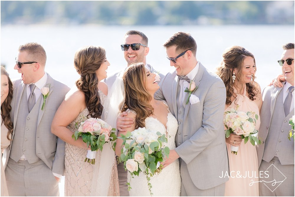 candid photo of the bridal party at clarks landing in point pleasant nj