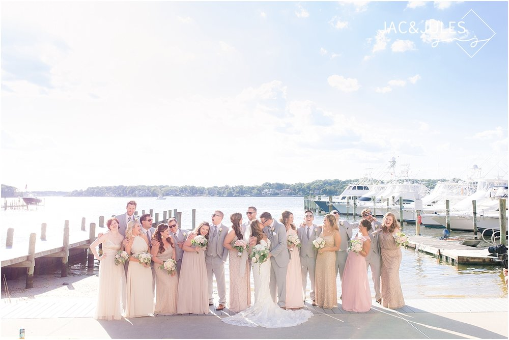 candid, natural photo of the bridal party at clarks landing yacht club in point pleasant nj