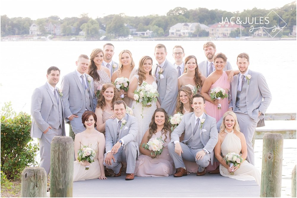 fun bridal party photo on the dock at clarks landing in point pleasant nj