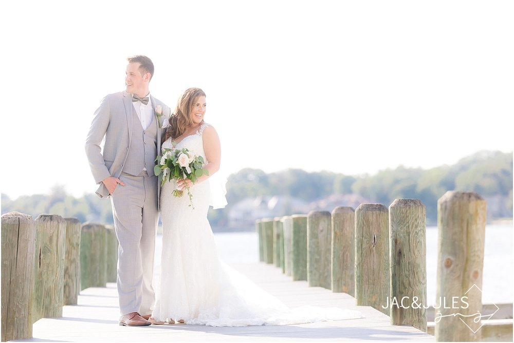natural light photo of bride and groom on the dock at clarks landing in point pleasant nj