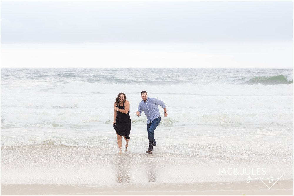 engagement photo on the beach in mantaloking nj