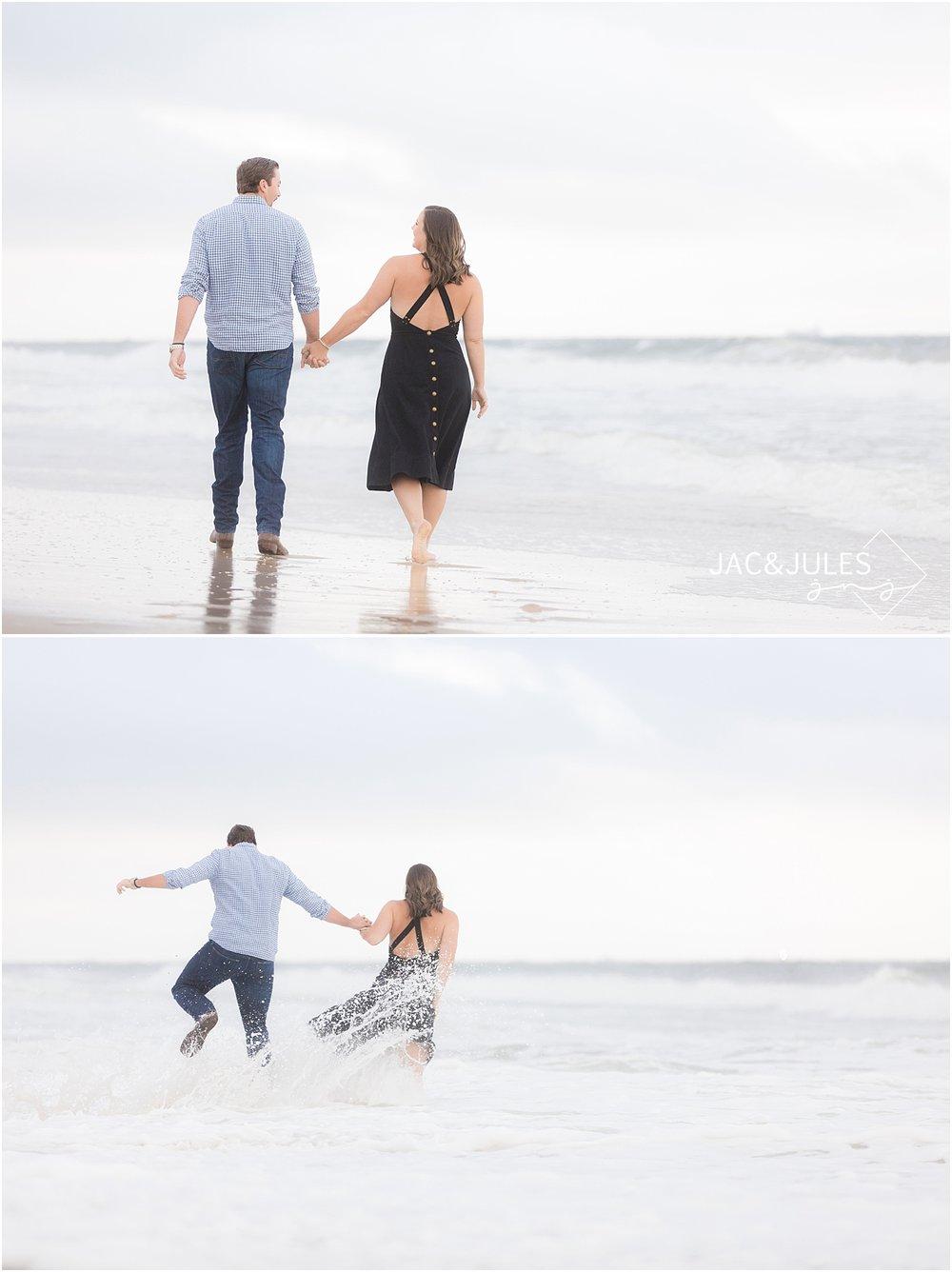 mantaloking engagement photo walking on the beach