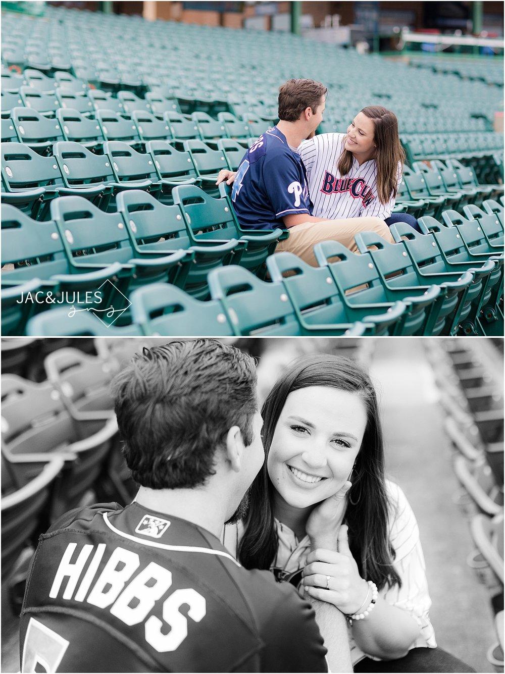 engagement photo at a baseball field