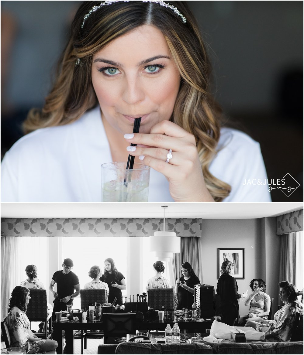 Bride sipping on a cocktail while getting ready at The Heldrich Hotel in New Brunswick, NJ.  Beauty teams from Boho Hair Salon and Masha Hair and Makeup