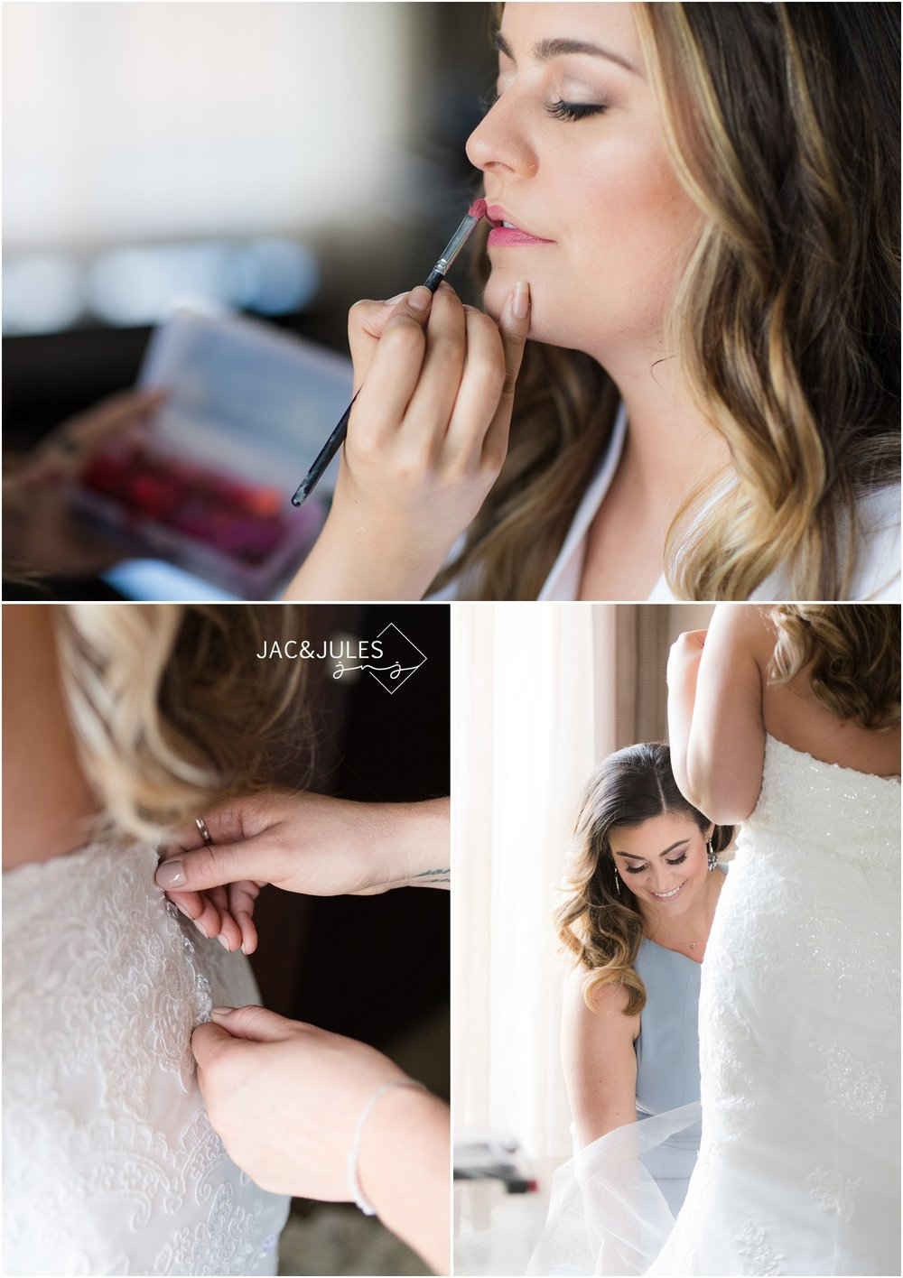 Bride getting lipstick from Masha Hair and Makeup.  Maid of honor helping bride into her wedding gown.