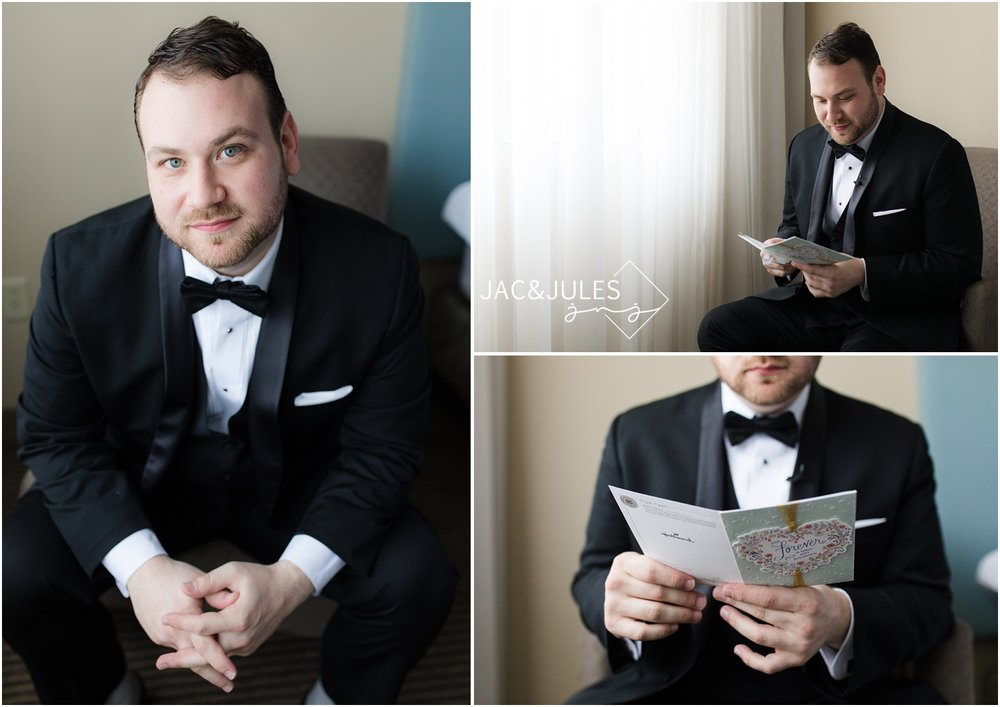 Photos of groom reading letter from bride at The Heldrich in New Brunswick, NJ.
