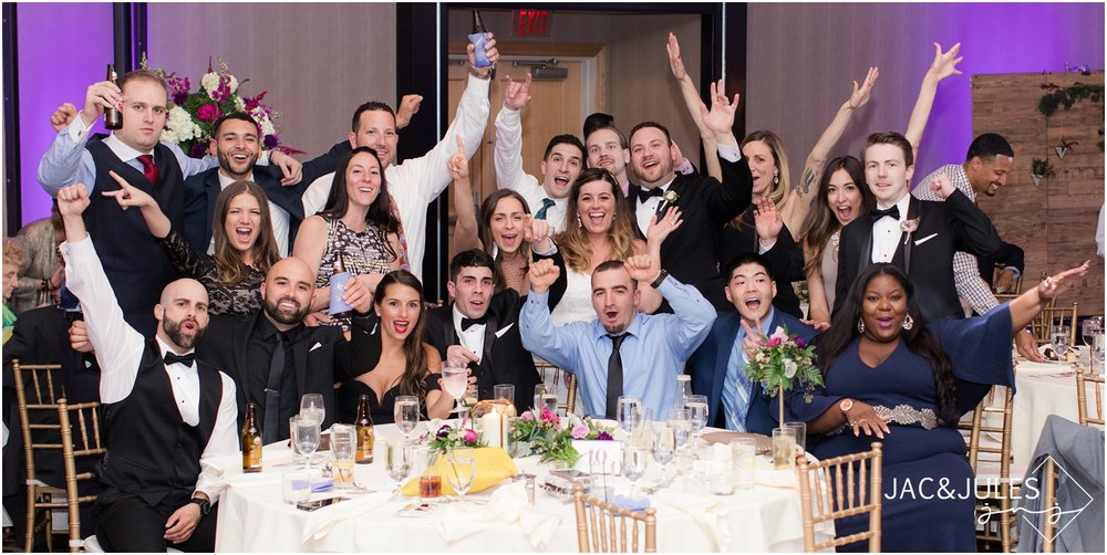 Crazy fun table photo of guests during wedding reception at The Heldrich in New Brunswick, NJ.