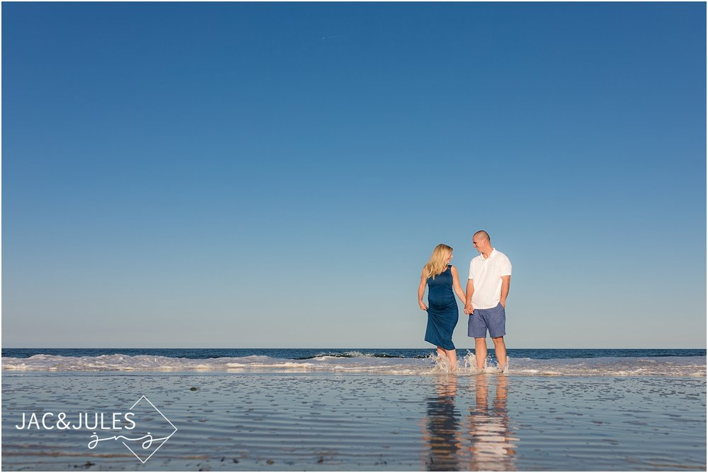 fun maternity photos in the ocean at the jersey shore