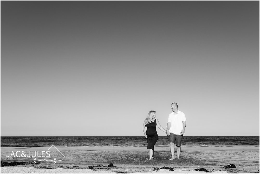 fun maternity photos at the beach in new jersey