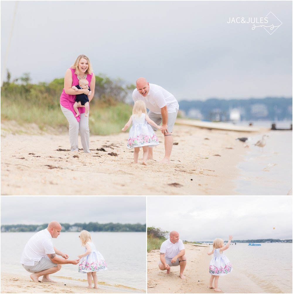 Photo of Little girl throwing rocks with her dad in Ocean Gate, NJ.