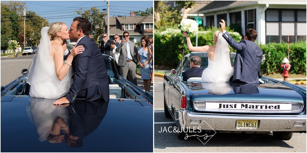 Bride and groom leave ceremony in antique car at All Saints Church in Bay Head, NJ.