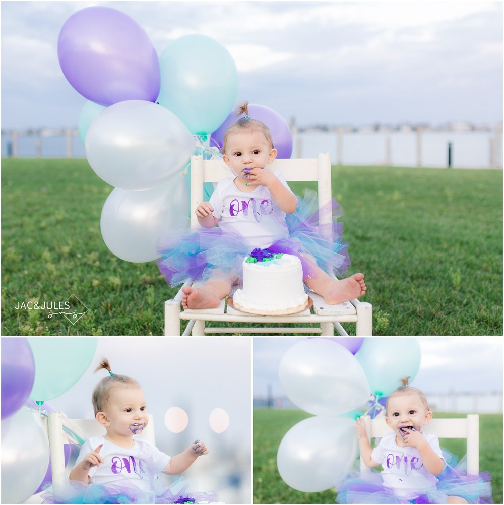 first birthday cake smash photos with balloons by the bay in Mantoloking, NJ.
