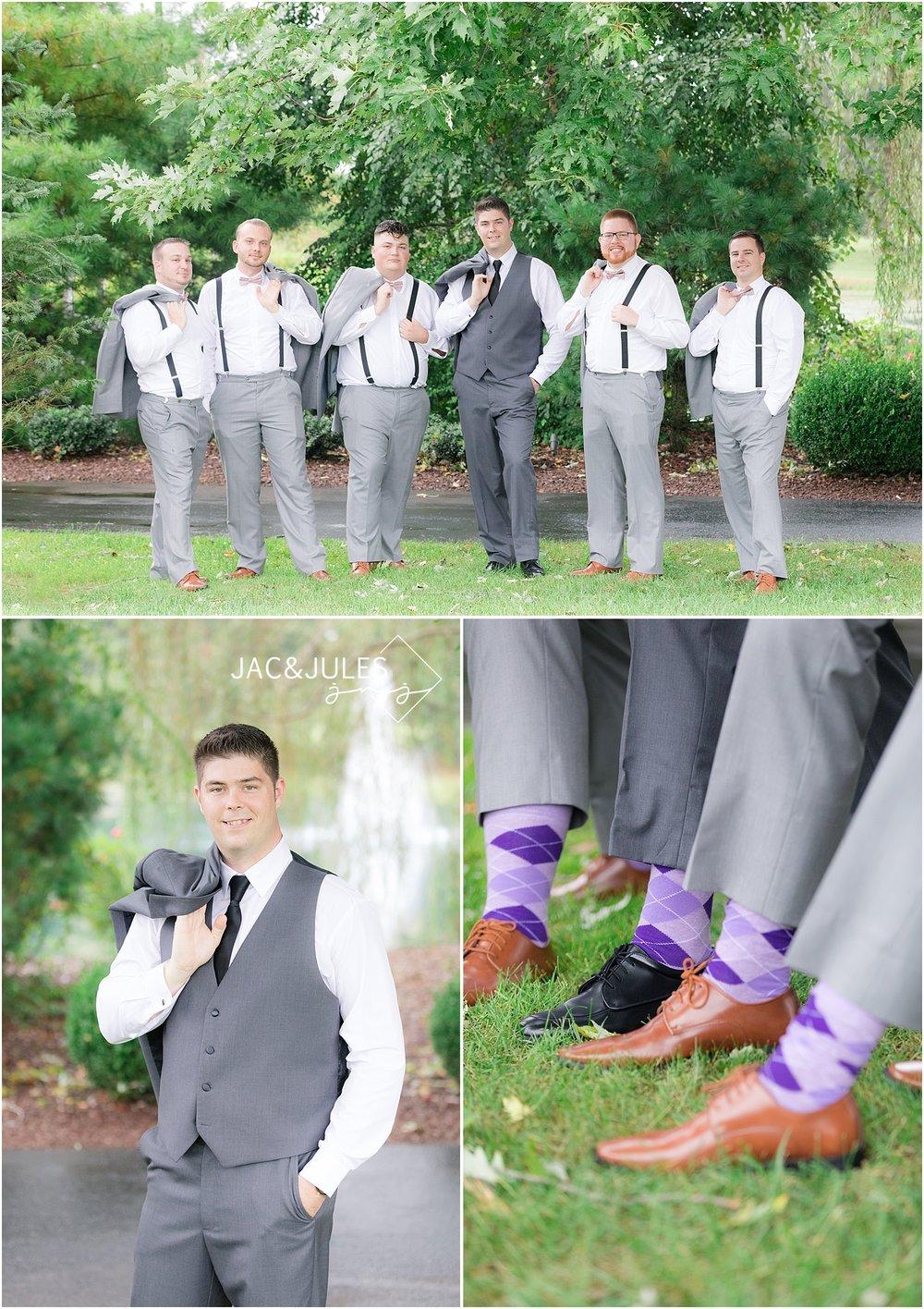 fun groomsmen photo at frogbridge with suspenders