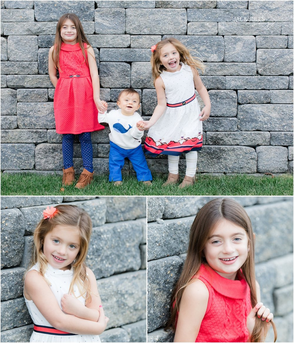 Holiday photos of three kids against a stone wall at home in Toms River.