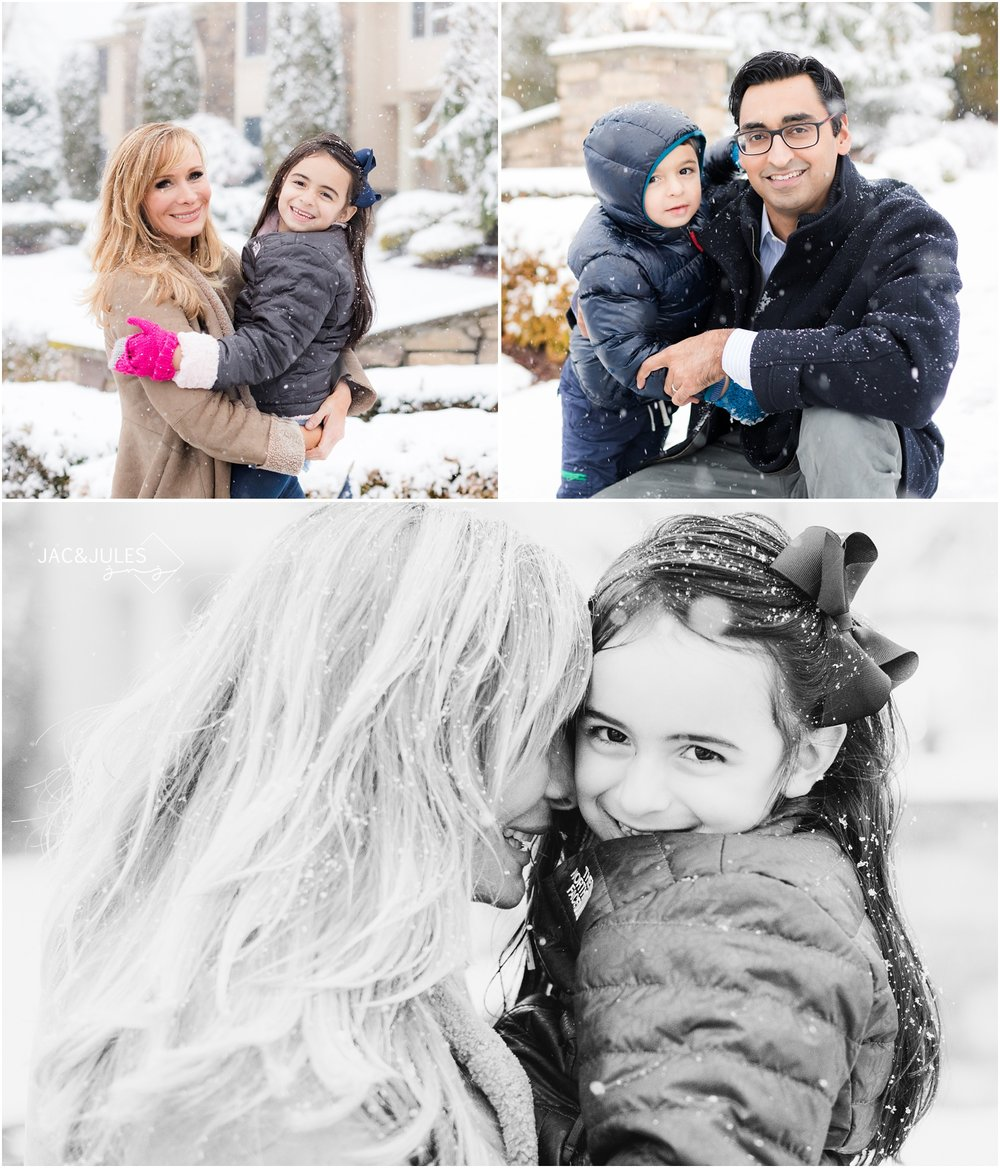 Cute family having fun in the winter snow in Marlboro, NJ home.