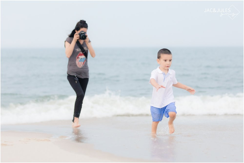 Photographers Jacqui and Julia of Jac&Jules photographing a child running in the ocean in 2017