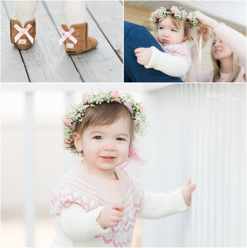 Winter First birthday photos with flower crown and ugg boots