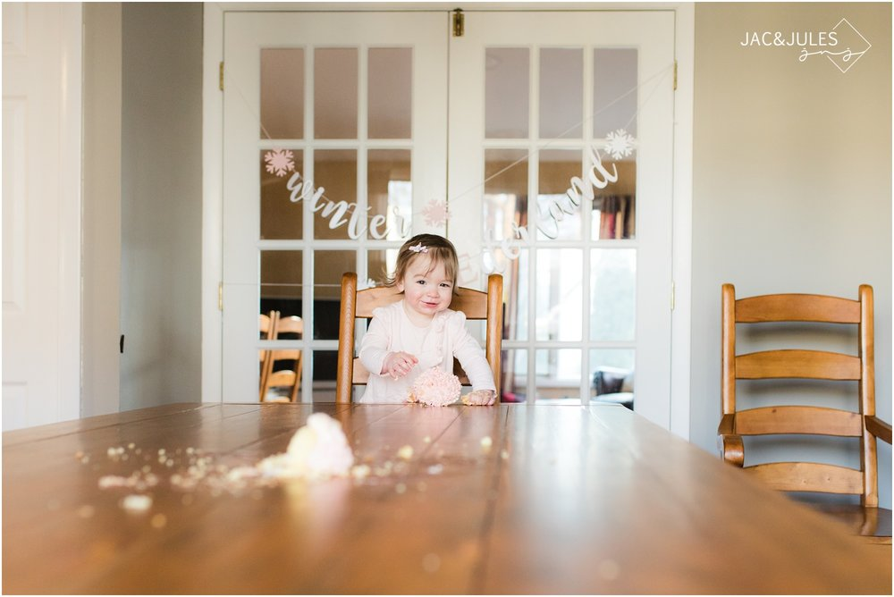 First birthday cake smash photos at home in Point Pleasant, NJ.
