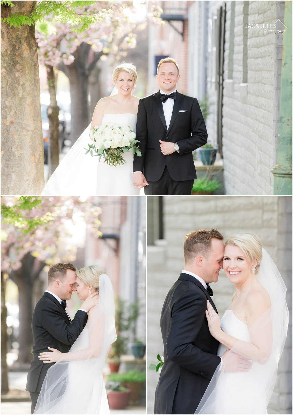 Pretty photos of bride and groom on cherry blossom lined street in downtown Baltimore, MD.