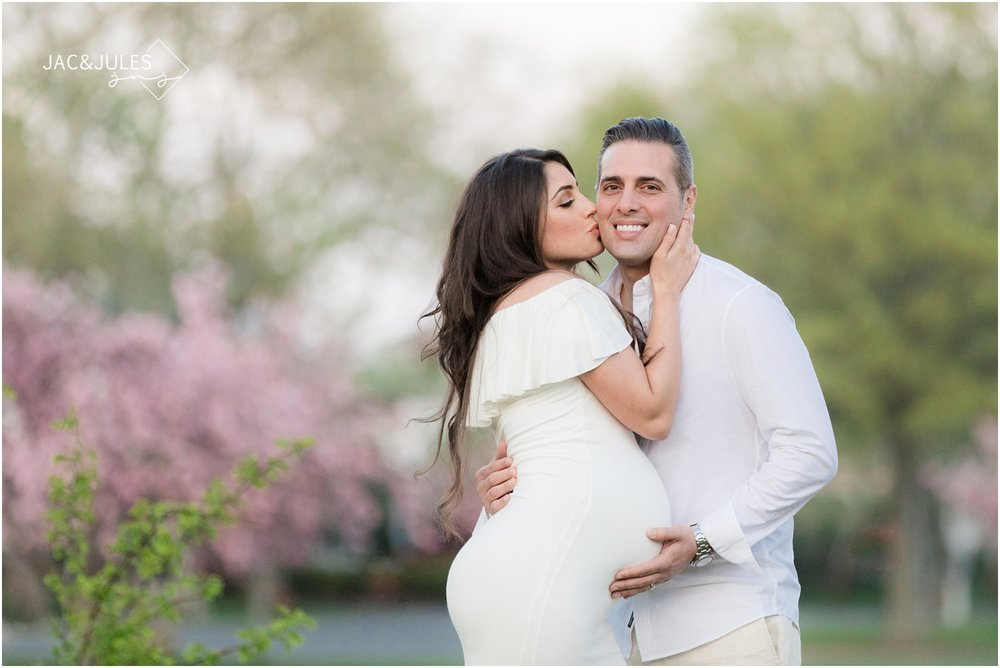 Pretty maternity photos with dady by cherry blossoms at Divine Park in Spring Lake, NJ.
