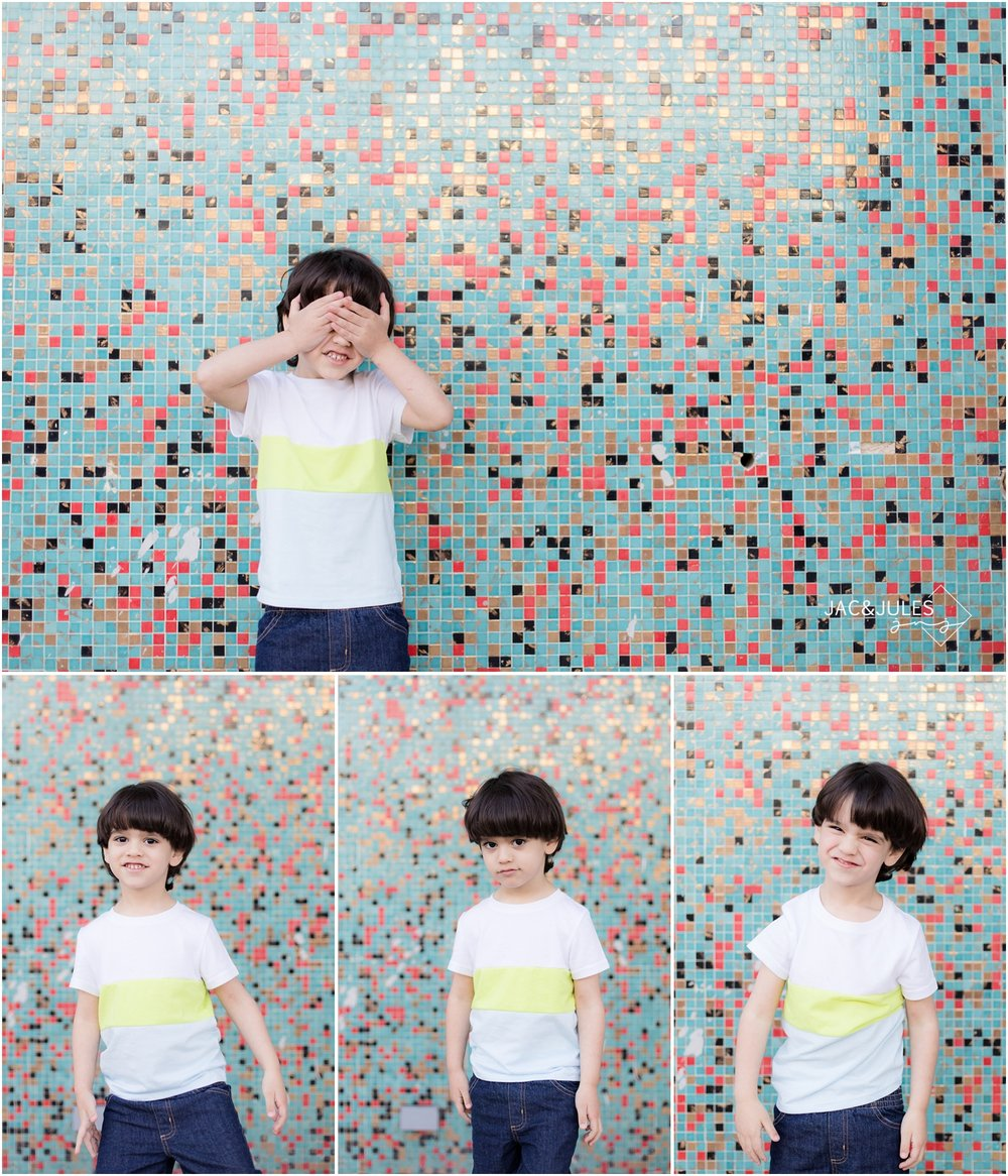 Fun photos of 3 year old boy full of personality in front of Mosaic wall in Asbury Park, NJ.