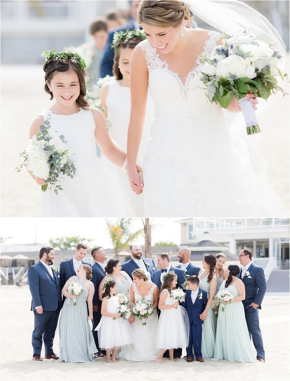 bride and flower girl walking on beach with bridal party in sea bright