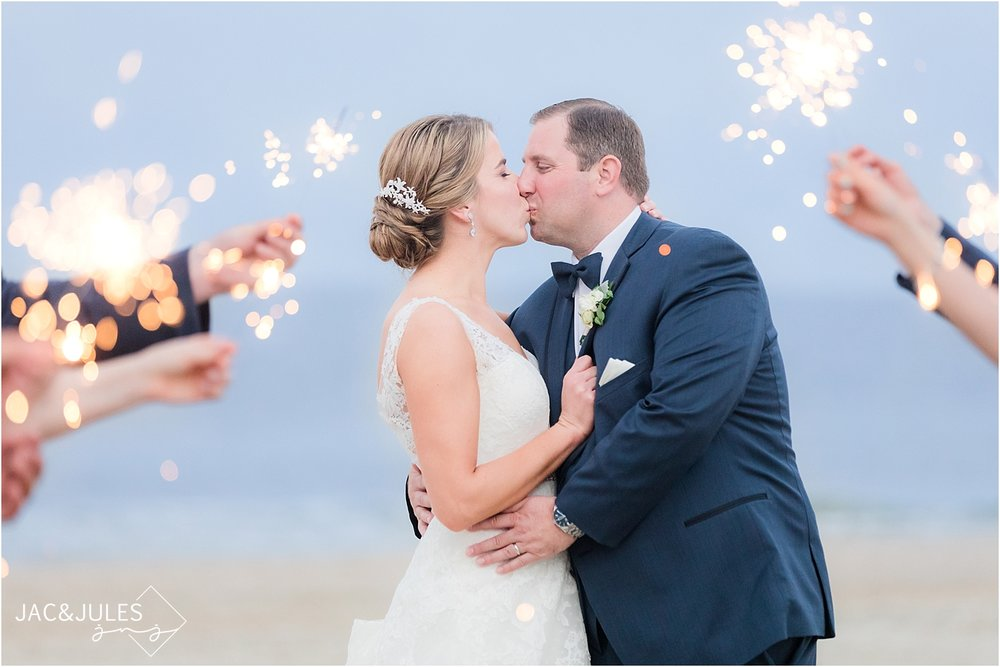 sparkler photos with bride and groom at windows on the water wedding in sea bright nj