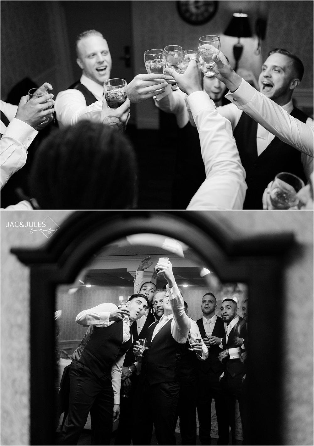 groom drinking with groomsmen at olde mill inn