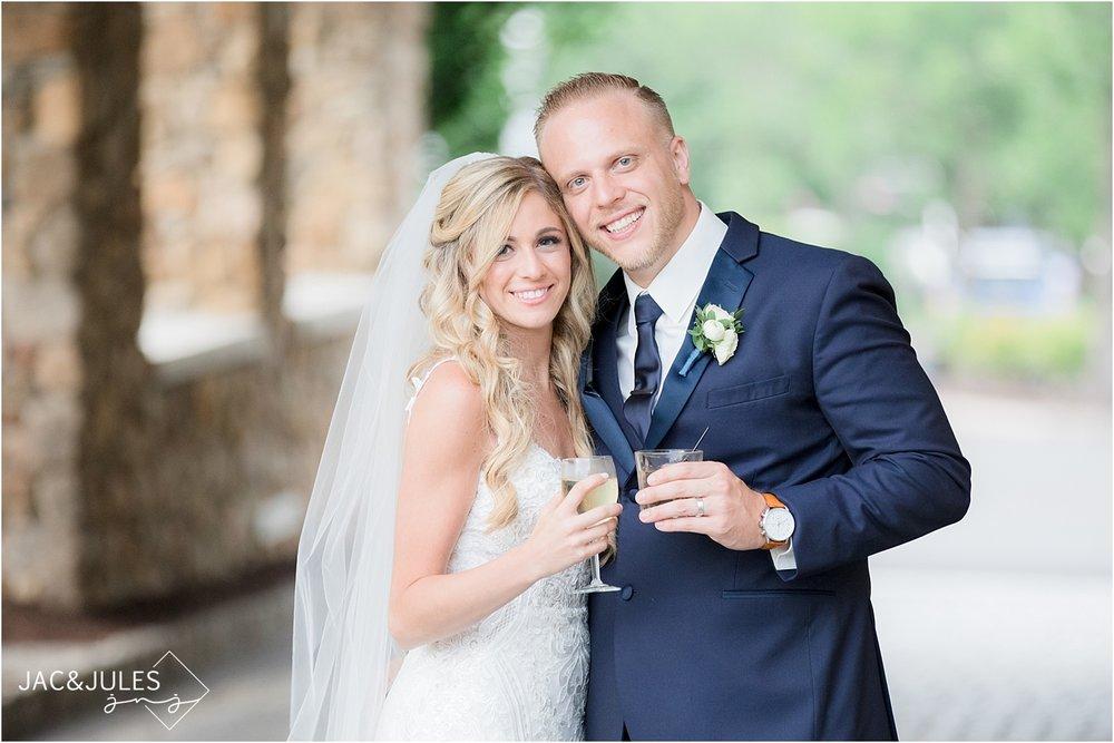 bride and groom cheers at olde mill inn
